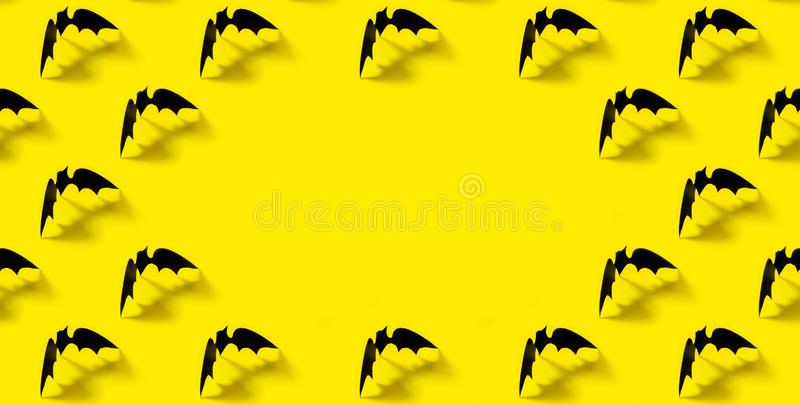 Black paper bat pattern with falling shadow on yellow background. Halloween decorations. Halloween concept banner. Flat royalty free stock photos