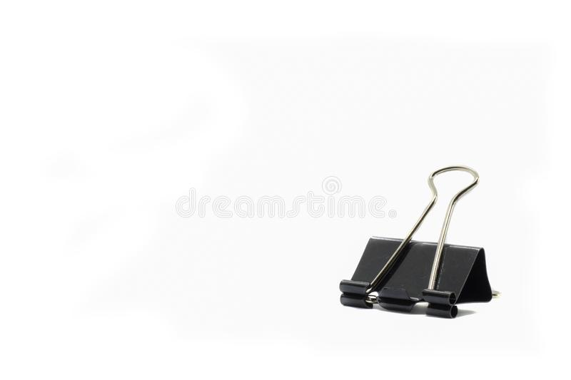 Black paper clip for office stationery isolated on white background stock photography