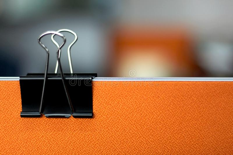 Black paper clips in the office. royalty free stock image