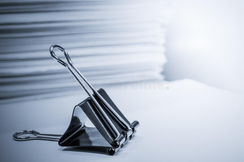 Black paper clips. And pile of document royalty free stock images