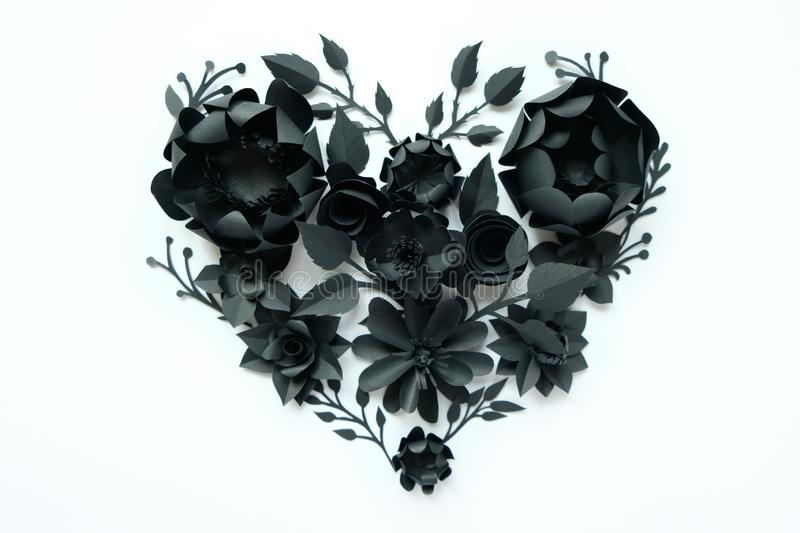 Black paper flowers, floral background, bridal bouquet, wedding, quilling, Valentine`s day greeting card, heart shape. On white background. Gothic royalty free stock photography