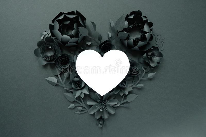 Black paper flowers, floral background, bridal bouquet, wedding, quilling, Valentine`s day greeting card, heart shape. On white background. Gothic stock photos