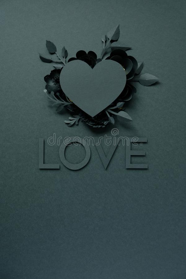 Black paper flowers, floral background, bridal bouquet, wedding, quilling, Valentine`s day greeting card, heart shape. On black background. Gothic. Lettering royalty free stock image