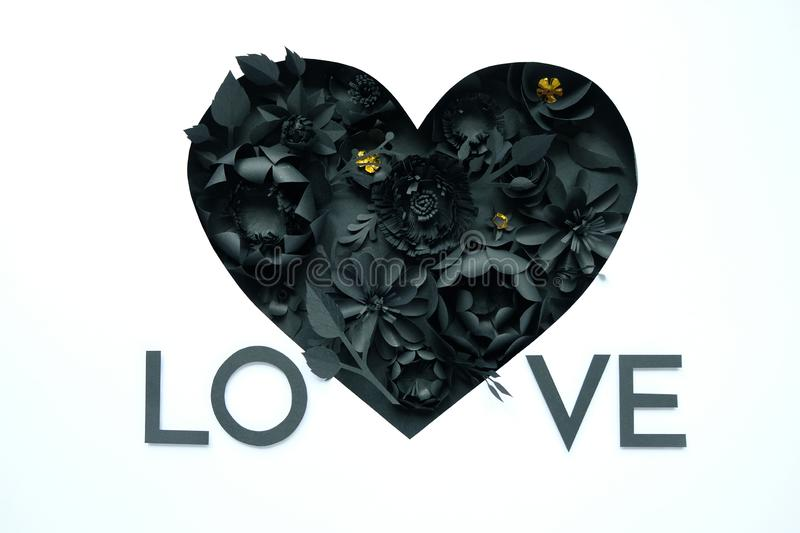 Black paper flowers, floral background, bridal bouquet, wedding, quilling, Valentine`s day greeting card, heart shape. On white background. Gothic royalty free stock images