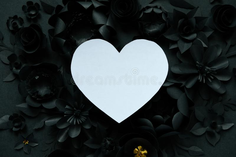 Black paper flowers, floral background, bridal bouquet, wedding, quilling, Valentine`s day greeting card, heart shape. On white background. Gothic royalty free stock image