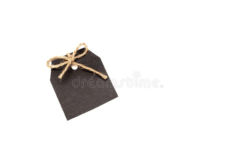 Black paper price tag with bow isolated on white background royalty free stock image