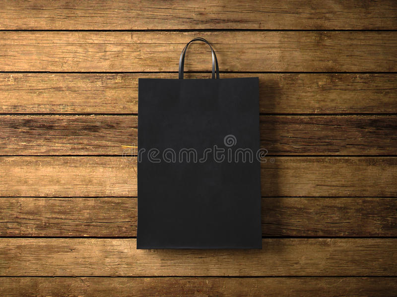 Black paper shopping bag on the wooden background. In focus. Horizontal. 3d render. Photo of black shopping bag on wooden background vector illustration