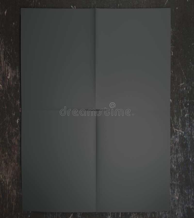 Black paper on wooden surface. Close up of black paper on wooden surface. Mock up, 3D Rendering royalty free illustration