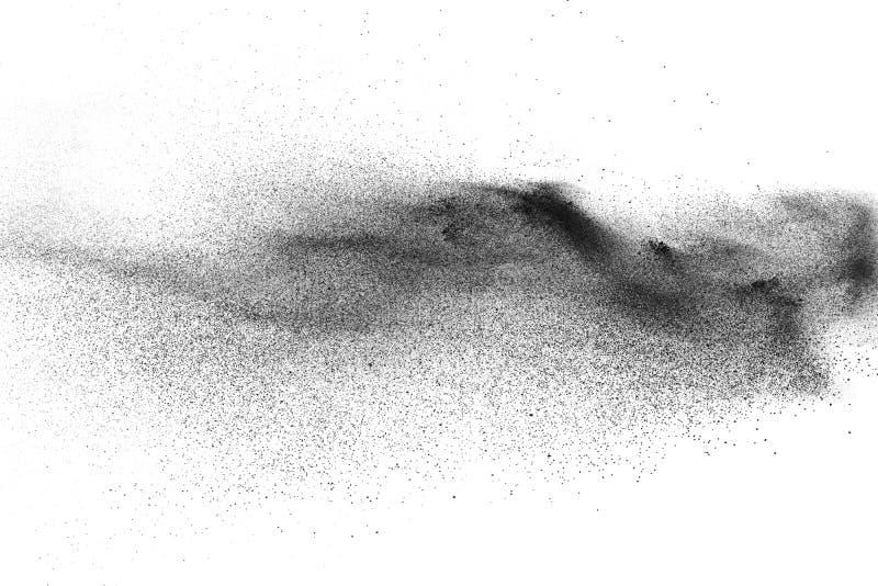 Black particles splatter on white background. Black dust splash on white background stock photography