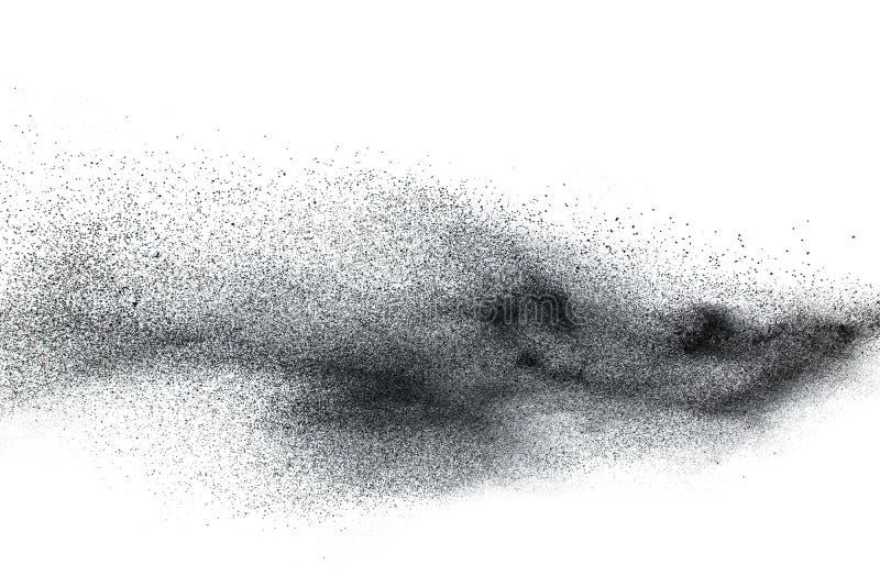 Black particles splatter on white background. Black dust splash on white background stock photo