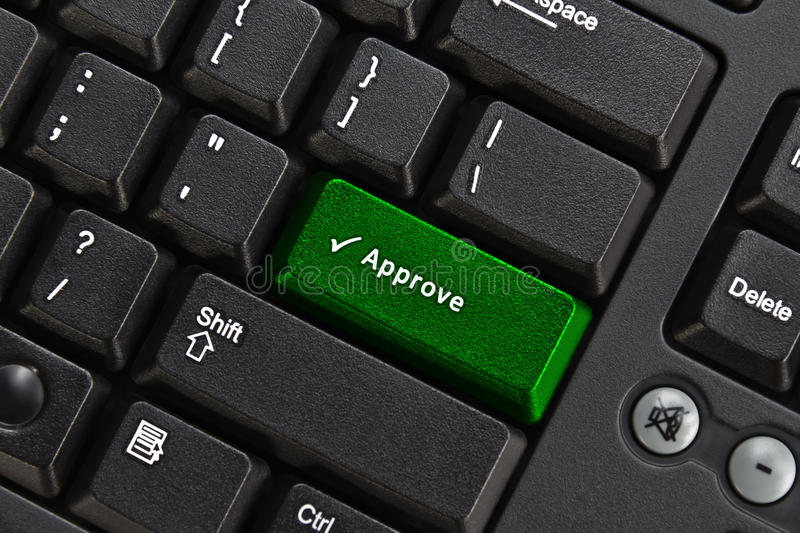 Black pc keyboard. Close up of black pc keyboard, focus on green approve key, authority concept stock photos