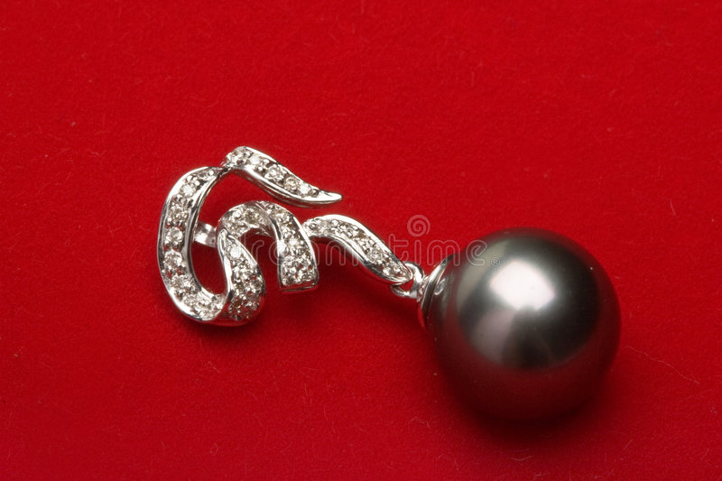 Black Pearl. Beautiful black pearl jewelry, in the white background royalty free stock photography