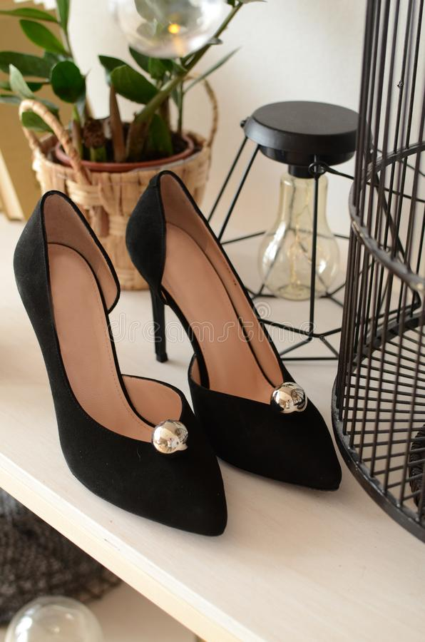 Black with a pearl high-heeled shoes elegant leather women`s shoes , geometry, light glossy heel shoes. Black with a pearl high-heeled shoes elegant leather royalty free stock photography