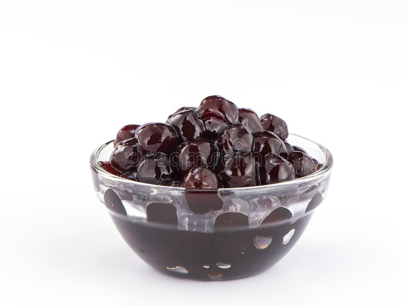 Black pearls. Boiled tapioca pearls for bubble tea on white background. stock images
