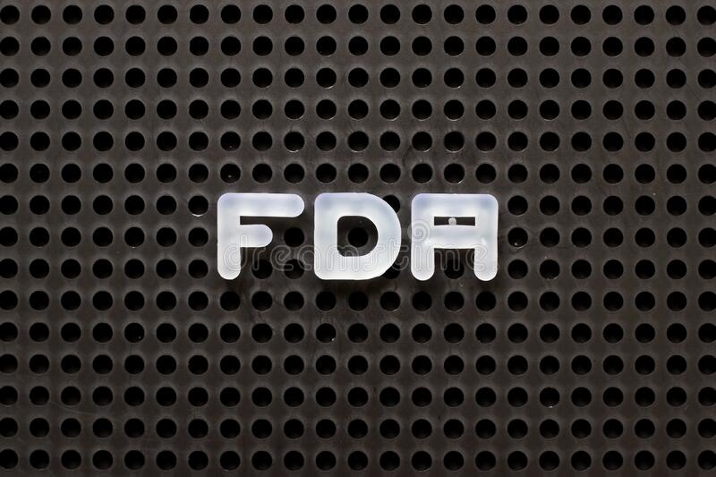 Black pegboard with white letter in word FDA abbreviation of food and drug administration. Black color pegboard with white letter in word FDA abbreviation of royalty free stock photo