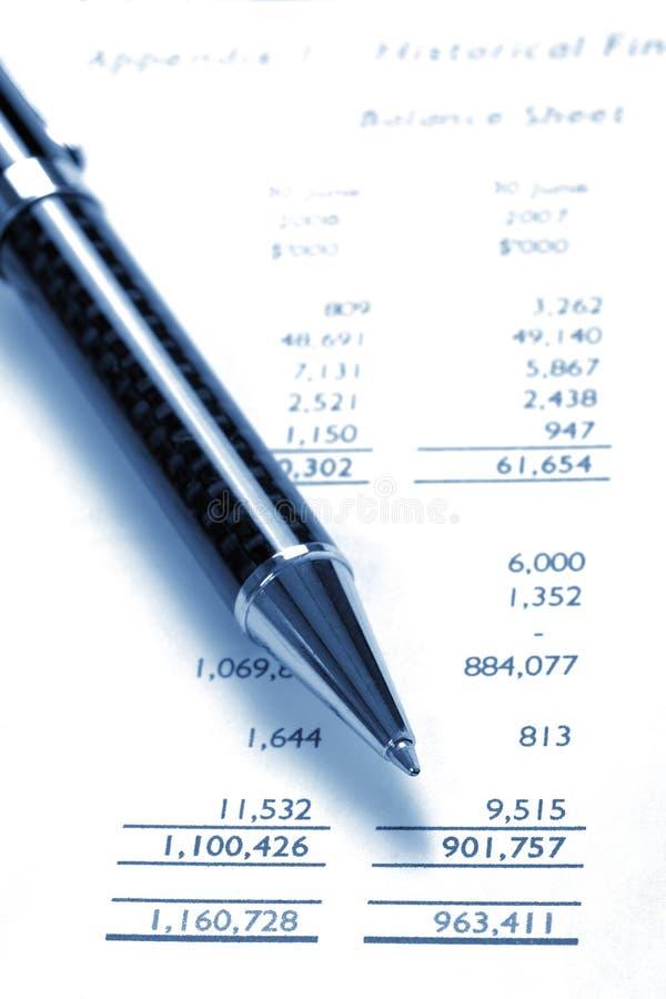 Black Pen On Financial Balance Sheet royalty free stock photo