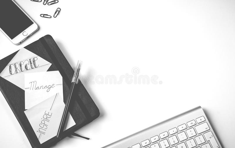 Black Pen Near Iphone and Apple Magic Keyboard stock photos