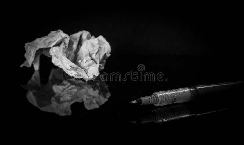 Black Pen Near White Printer Paper stock image
