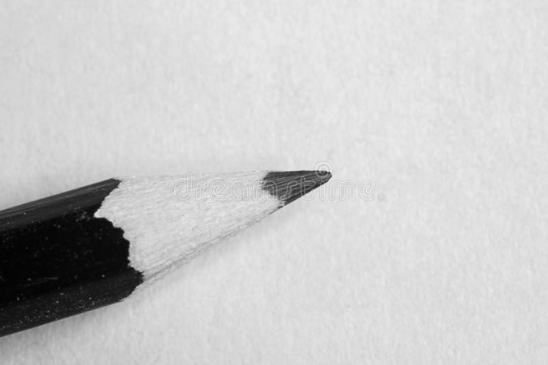 Black pencil isolated on white royalty free stock photography