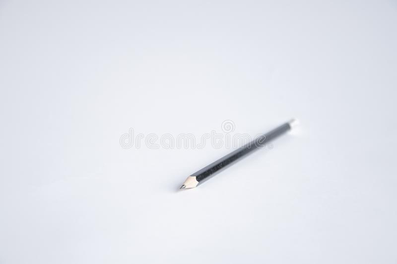Black pencil lies on the table stock image