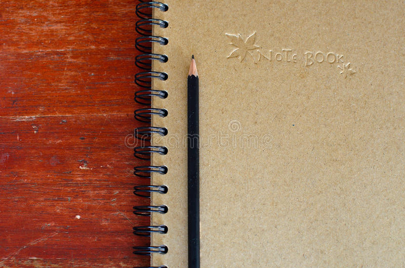 Download Black pencil on note book stock photo. Image of office - 23574780