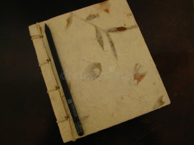 black-pencil-on-notebook royalty free stock photos