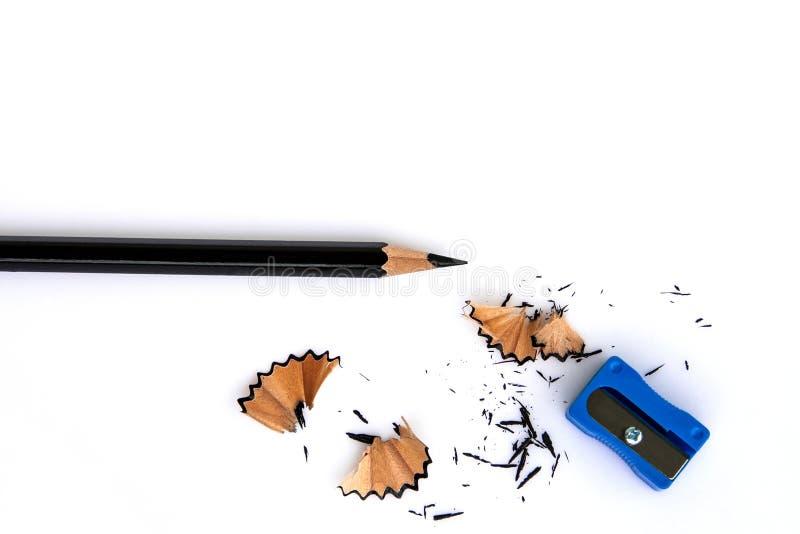 Black pencil ,pencil sharpener and pencil scraps royalty free stock photos