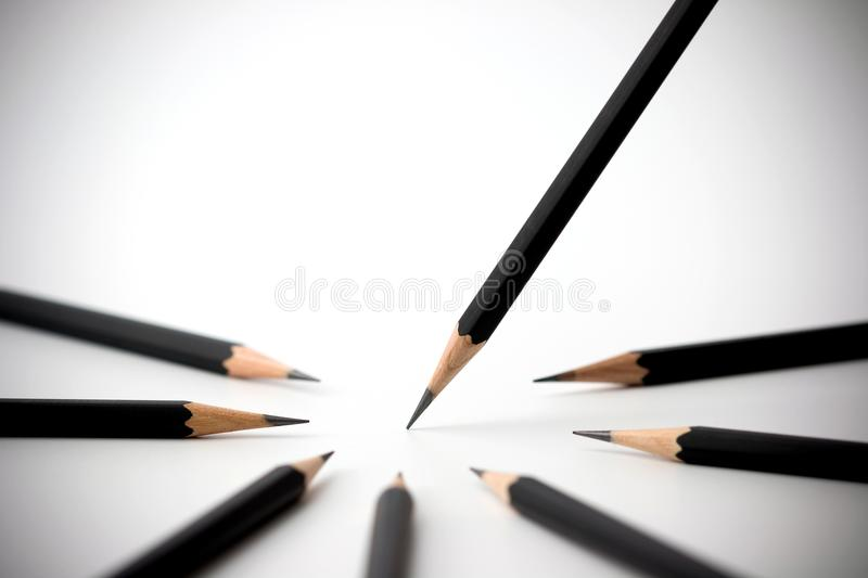 Black pencil standing out from crowd of plenty identical black fellows. business success concept. Black pencil standing out from crowd of plenty identical black stock image
