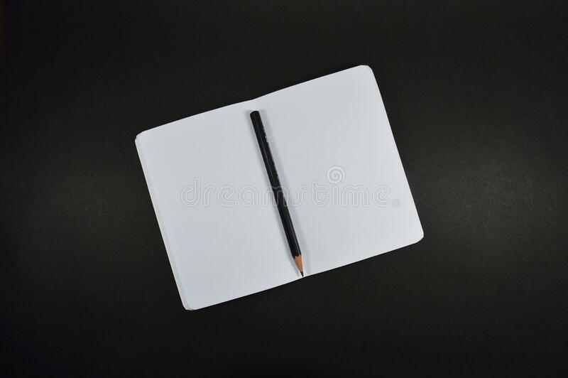 Black Pencil on White Paper stock photos