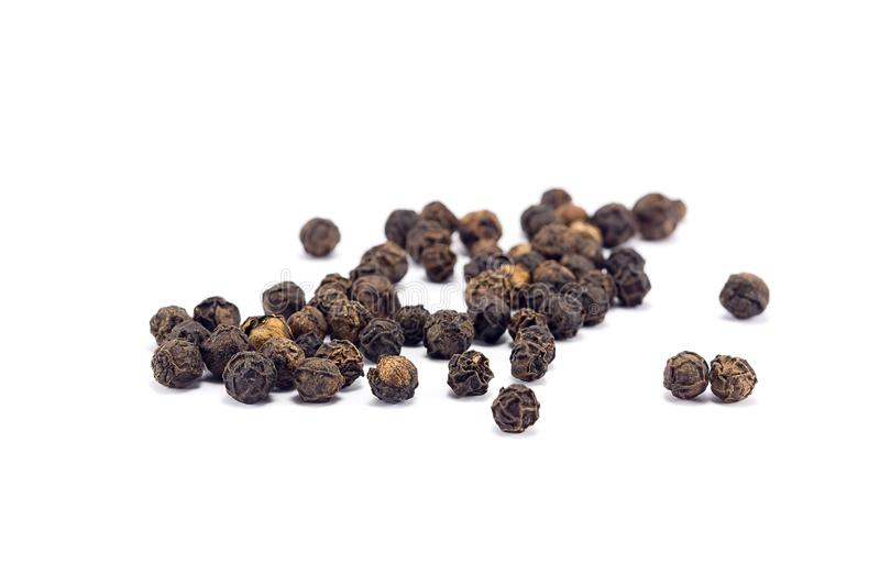 black pepper grains isolated royalty free stock photo