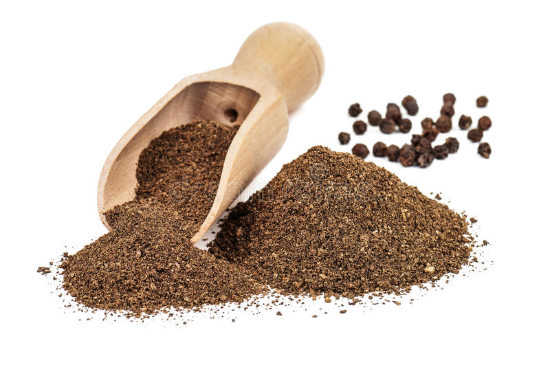 Black pepper ground. (powder) on white background royalty free stock photography