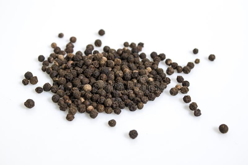Black pepper isolated in a white background stock photography