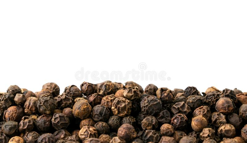 Black pepper peas on a white, isolated. Place for text stock photos