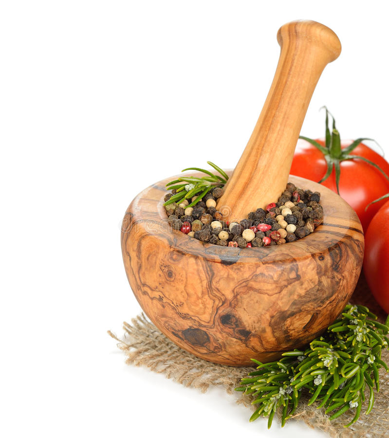Black pepper in wooden mortar royalty free stock photography