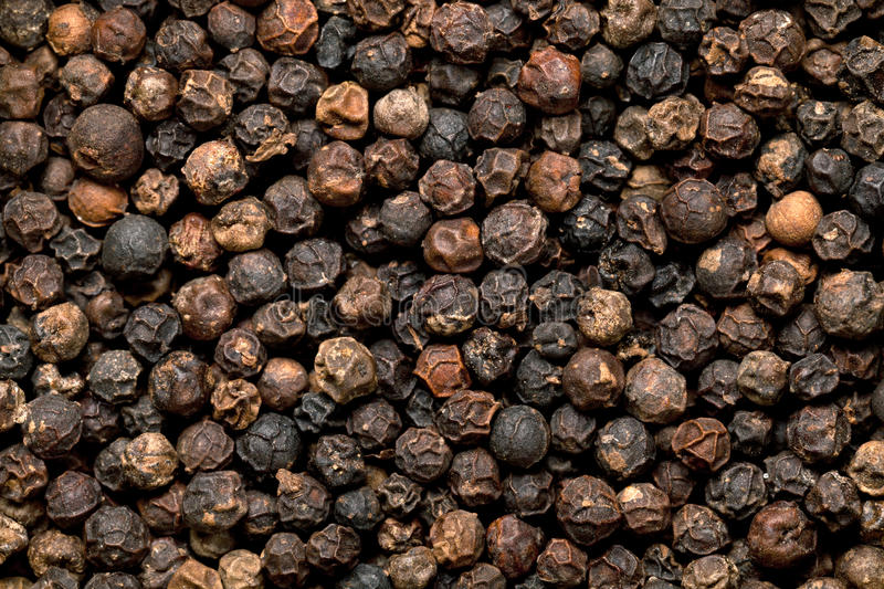 Black Peppercorn. Seeds background. Macro shot, top view stock photography
