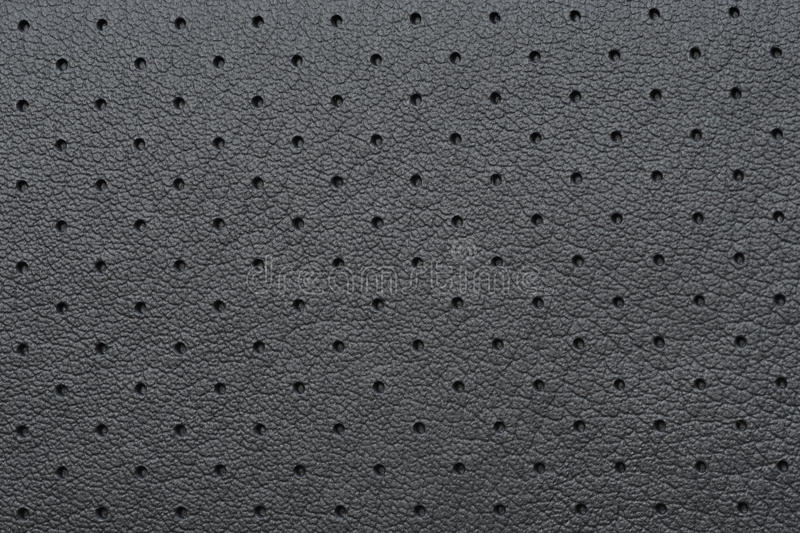 Black Perforated Leather or Skin Texture. As Wallpaper or Background royalty free stock photos