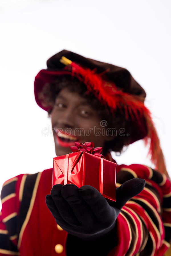 Download Black Pete showing gift stock image. Image of event, netherlands - 40068919