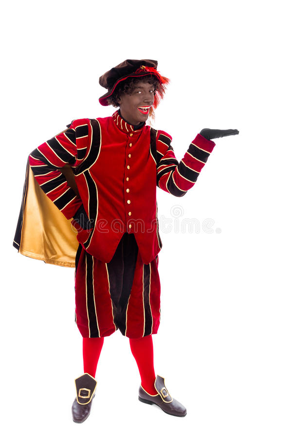 Black Pete showing object. Zwarte piet ( black pete) with gift . typical Dutch character part of a traditional event celebrating the birthday of Sinterklaas ( stock photo