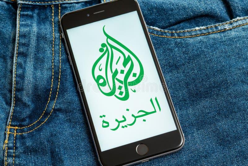 Black phone with logo of news media Al Jazeera on the screen. stock images