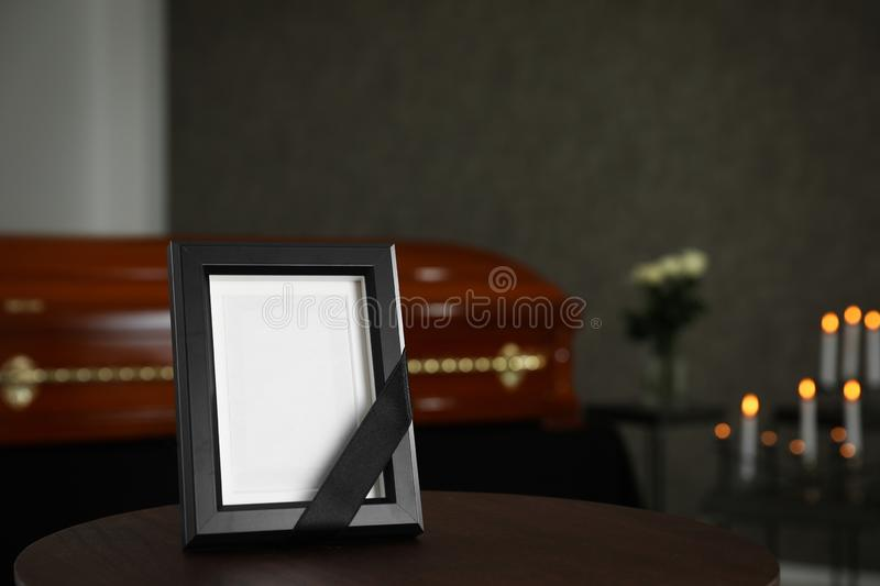 Black photo frame on table in funeral stock images