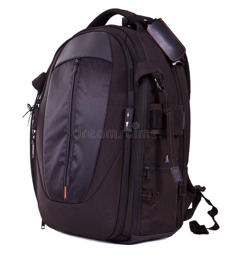 Black photo knapsack. On white background royalty free stock photos