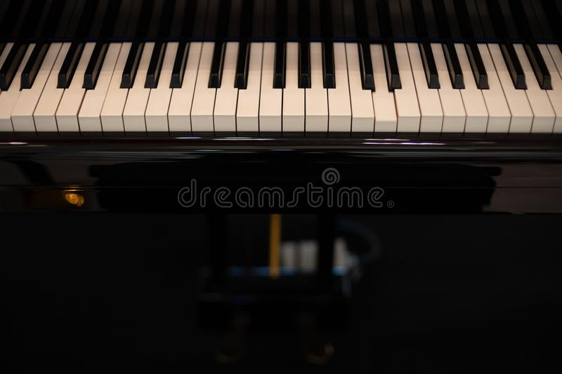 Black Piano and Piano keyboard as music and entertainment background stock image