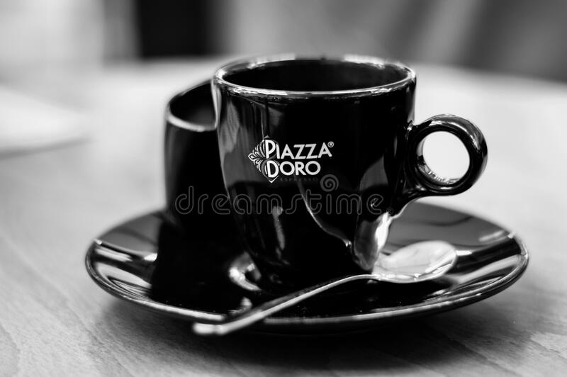 Black Piazza Doro Cup With Silver Spoon royalty free stock photo