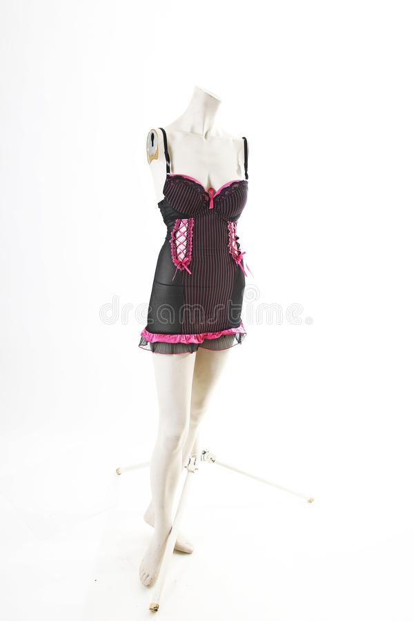 Black pink Babydoll lingerie on mannequin full body shop display. Woman fashion styles, clothes on white studio background. stock image