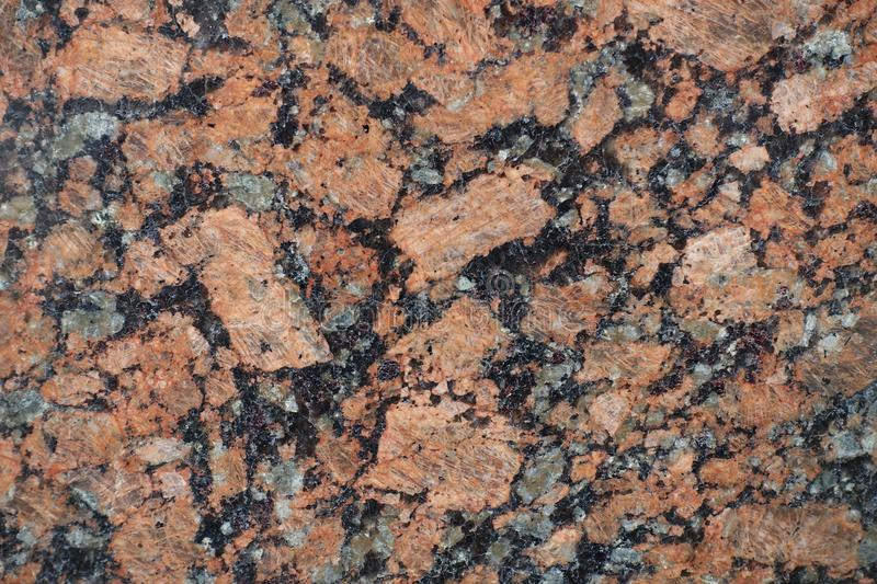 Black, pink and gray polished granite stone stock image