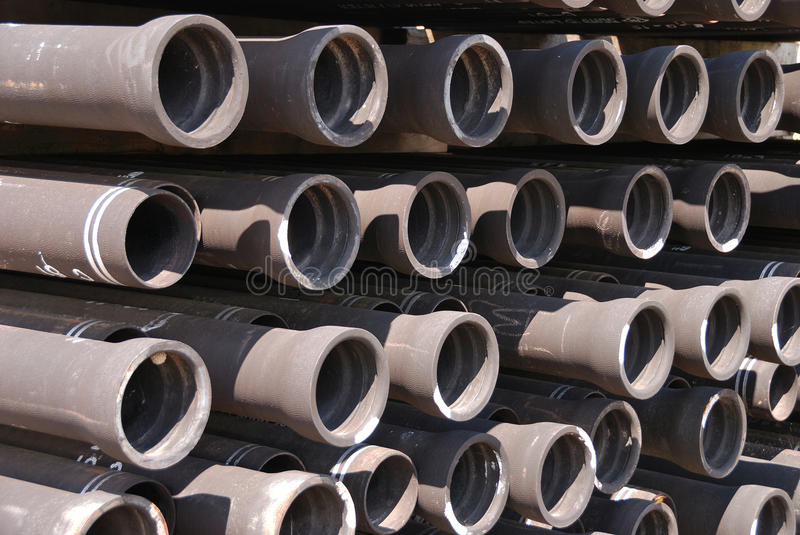 Water Pipe. Black Pipe Rows, 8 inch Iron Ductile water pipe stacked up at pubic Works Shop stock images