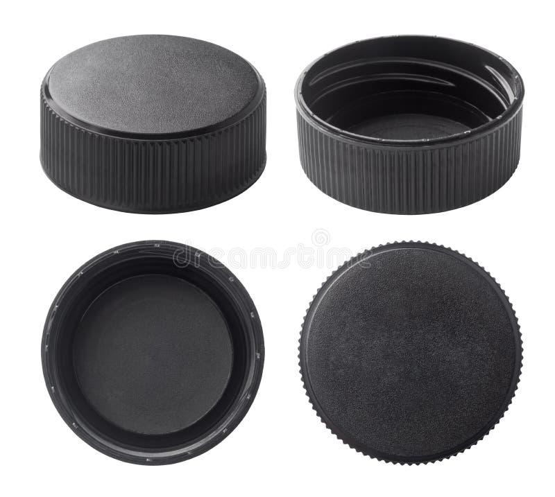 Black plastic bottle caps. Isolated on white background stock image