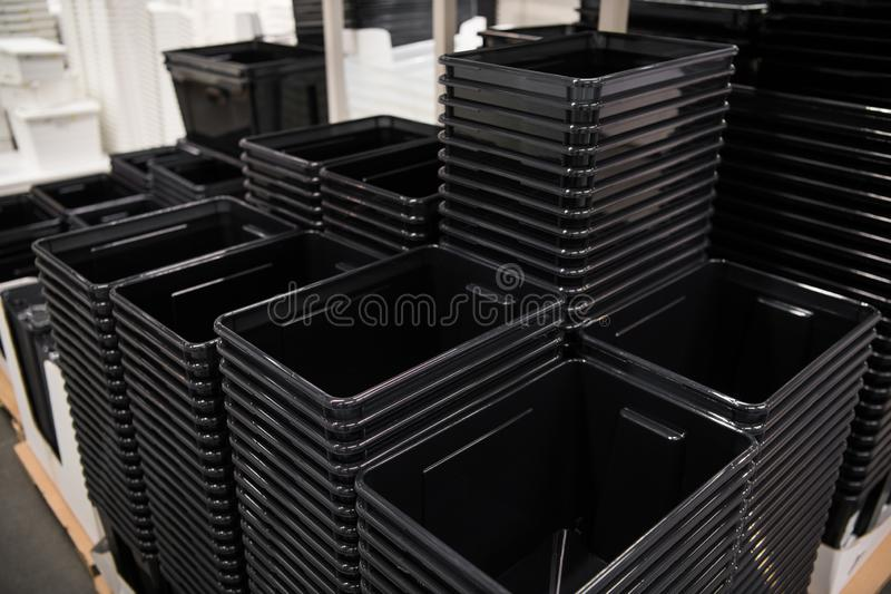 Black plastic box containers in row at store royalty free stock photography