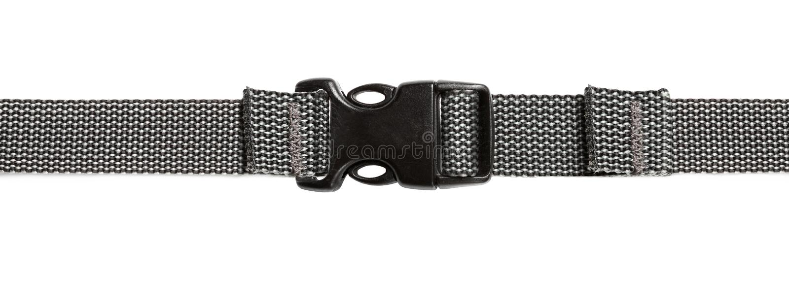 Black plastic buckle on strap. Isolated on white background stock photography