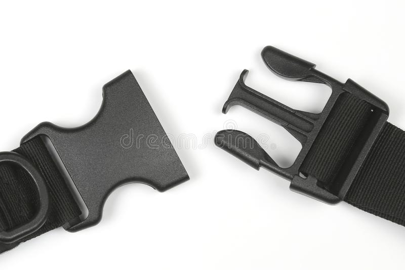 Black plastic Fastex clip for backpacks on a white background stock image